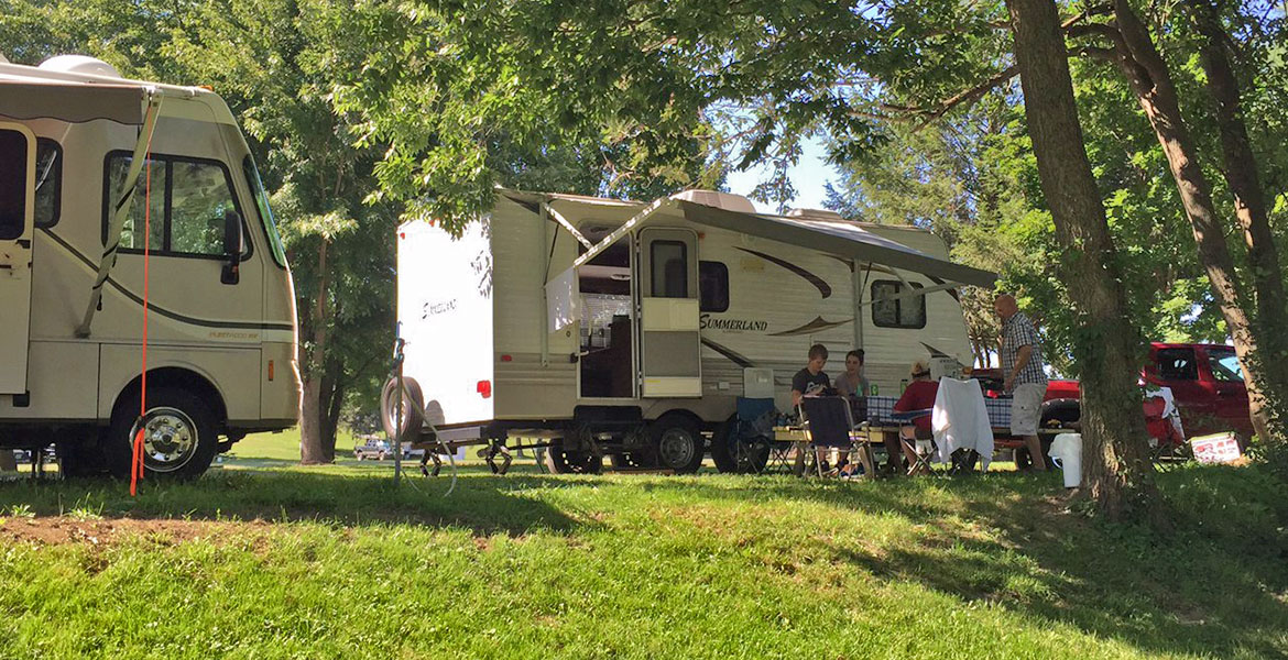 RV Site with Family sitting outside
